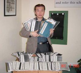 Grandmaster Doc-Fai Wong holding the Choy Li Fut Scripts